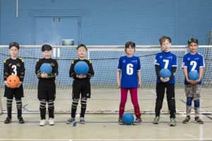 Group photo of two junior goalball teams