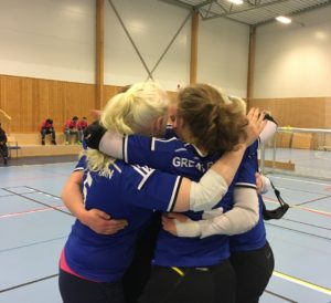 Photo of GB women hugging at the conclusion of a goalball game
