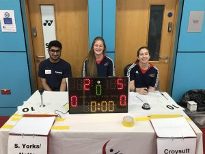 Photo of smiling activators and officials on the table at a Goalball UK tournament