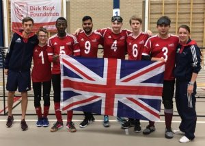 Group photo of GB players and coaches with the Union Flag