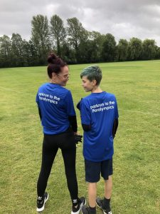 Kimberley and Bobby-Jack Spencer-Sallis modelling their 'parkrun to the Paralympics' t-shirts at Winchester parkrun