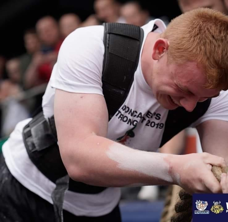 Chris Colbert, taking part in a strength challenge