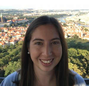 Ashleigh smiling, with Prague in the background