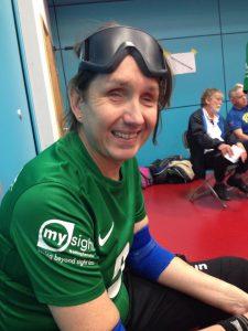 Sarah in her goalball kit, smiling