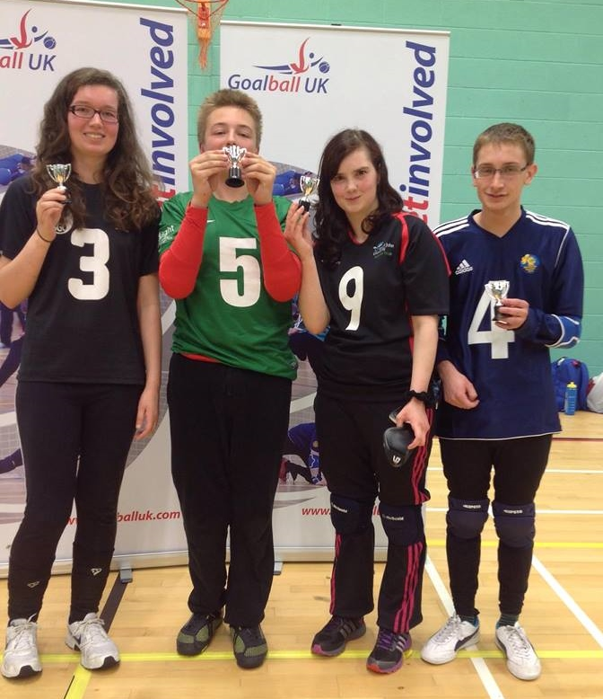 The winning group from the second pool holding their trophies