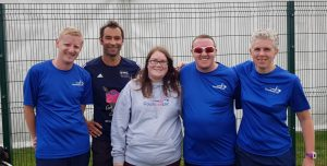Image shows attendees of the 2019 Goalball UK conference stood with Goalball UK members of staff