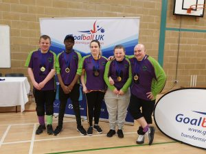 The current Croysutt Warriors Novice Squad, and coach Tommy, at a recent Goalball UK tournament