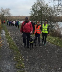 Image shows a Goalball UK parkrun participant with their guide dog