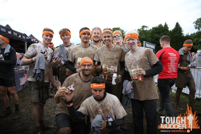 The Tough Mudder participants stood together after the race, in their Goalball UK T-shirts covered in mud