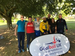 Image shows members of the Goalball Family stood together at a park run.