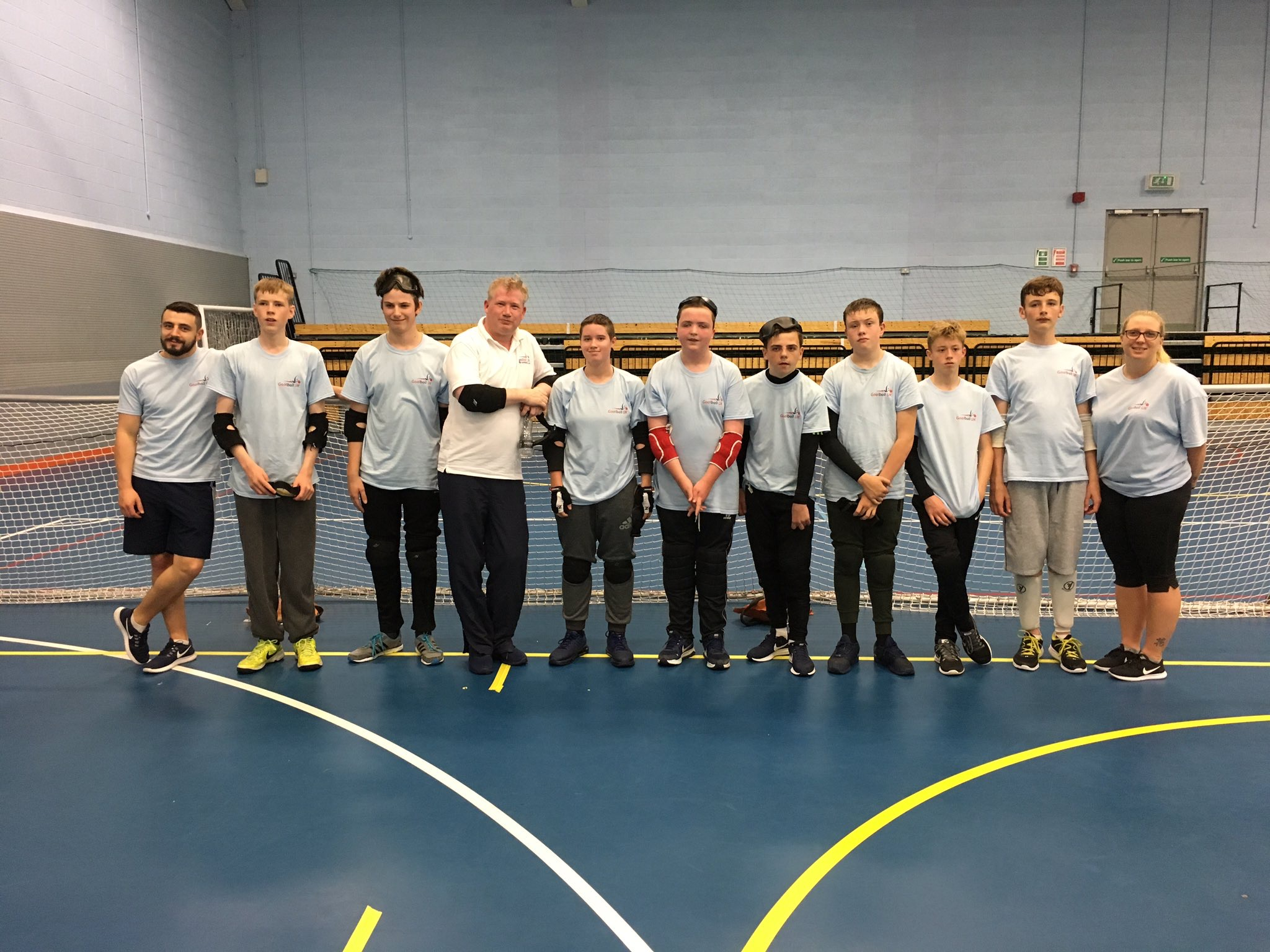 Mark winder stood with the attendees of the 2017 goalball summer camp