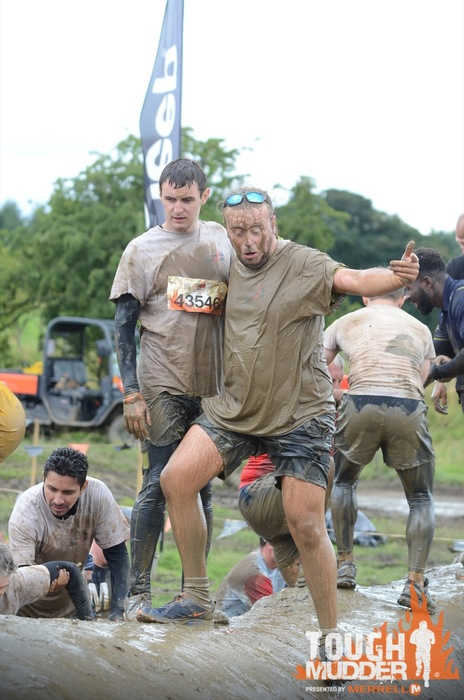 Action shot of our participants going through the Mud Mile obstacle