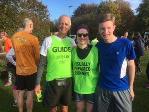 Image shows members of the goalball family smiling at a parkrun