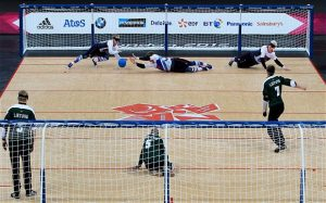Image showsGreat Britain's Michael Sharkey (left), Niall Graham and Adam Knott (right) in action against Lithuania during the Mens's Goalball at the Copper Box in London.