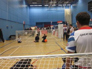 Image is an action shot of a goalball taster session