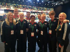 Image is of the Team GB women's goalball squad stood for a photo at the National Paralympic day celebration