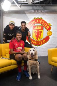 Image shows Rainbow sat down with Marcus Rashford and Jesse Lingard after meeting them