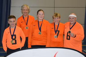 A blast from the past with Croysutt Warriors playing in orange! Tom is far right and Robin is second from the left.