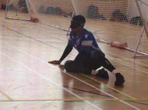 Devante Claridge in the goalball ready position mid match.