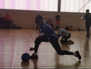 Devante Claridge shooting a goalball mid match.