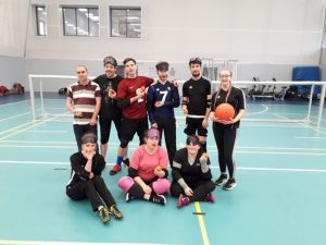 Group photo of West Yorkshire & Yorks St John players holding oranges to stay healthy!