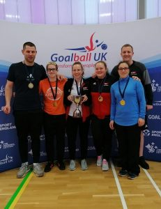 RNC team photo after winning gold in the intermediate finals with a predominantly women's team. Aaron Ford is in the far right.