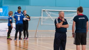 Photo of Robert Avery and Chris Davies talking at half time of a goalball game.