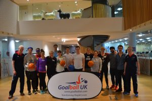Group photo of a Corporate Event. Kathryn Fielding and Adam Knott in attendance.