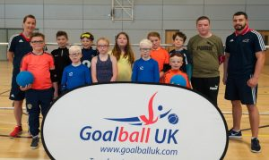 An image featuring lots of smiley faces and the Junior end of season tournament. This also features GB Men's Head Coach Faye Dale and star player Dan Roper.