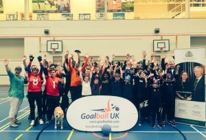 London Cup 2019 group photo with everyone's hands in the air smiling in elation!