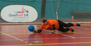 Sally Britton getting her finger tips to a goalball.