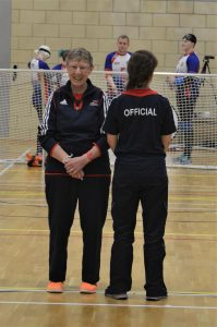 Dina Murdie laughing at a timeout with another official