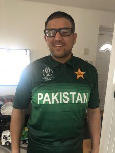 Abu-bakr Ishtiaq posing in his Pakistan Cricket shirt.