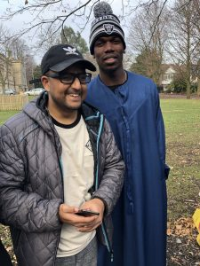 Abu-bakr Ishtiaq meeting Paul Pogba, football player of Manchester United.
