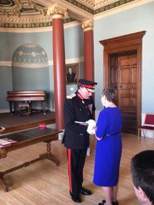 Dina Murdie receiving her British Empire Medal.