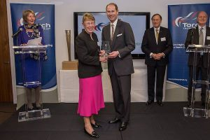 Dina Murdie receiving an award from the Torch Trophy Trust.