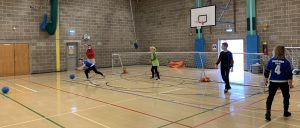Cambridge Dons returning to training in October 2020. Image shows players distanced throwing goalballs.