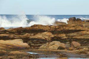 Waves crashing against Hopeman East Beach on a sunny day!