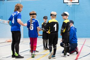 Warren Wilson coaching a group of junior players during a goalball session.