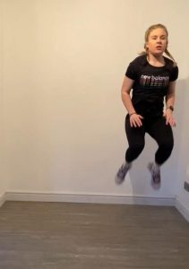 Image shows Megan mid-jump in a tucked position