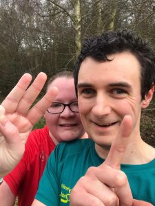 Anthony and Loren with their fingers representing 3.1 miles (5k)