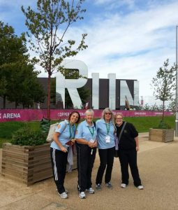 Image shows Judith stood outside the Copper Box arena with friends