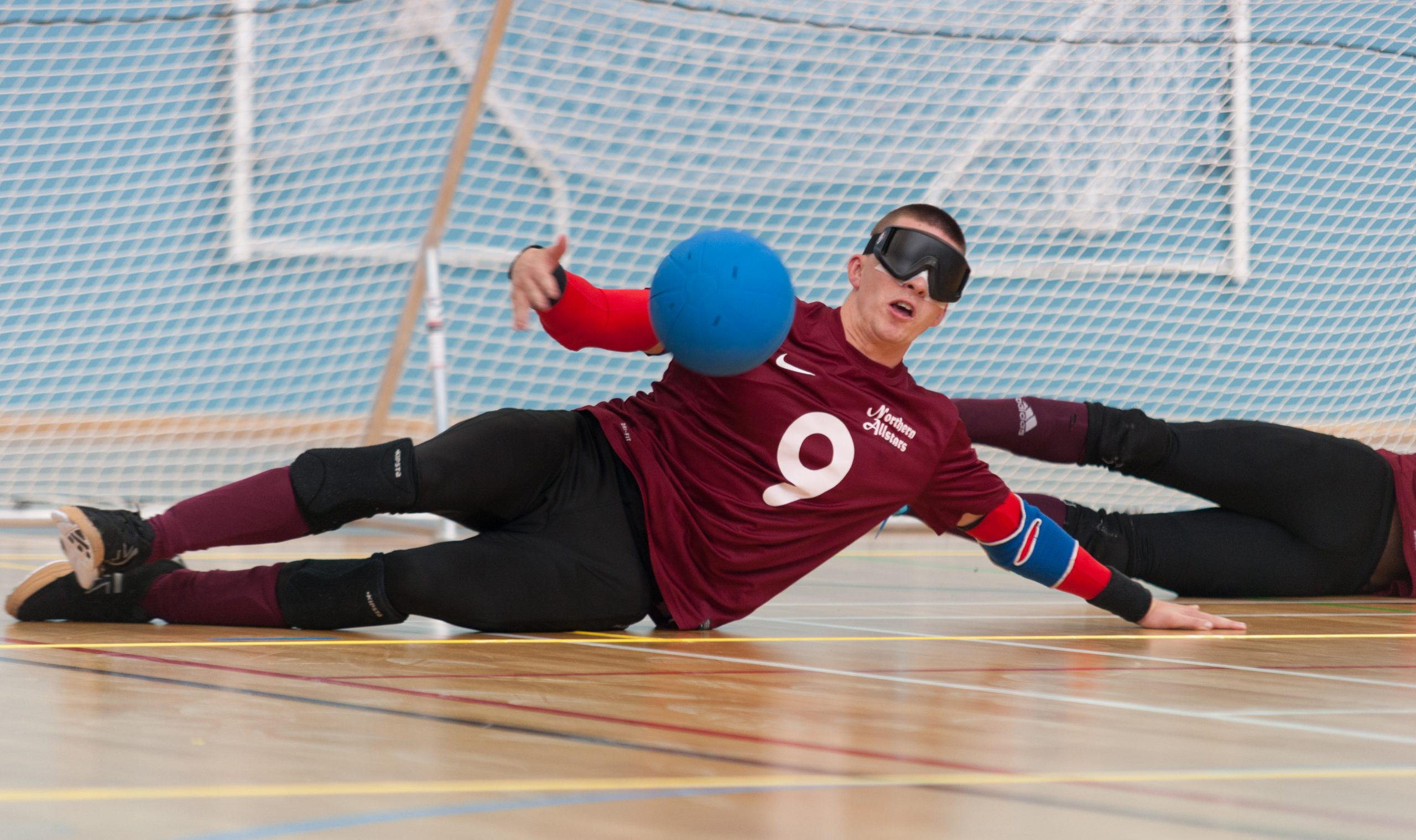 Action shot of Matt Loftus mid-save whilst playing for the Northern Allstars