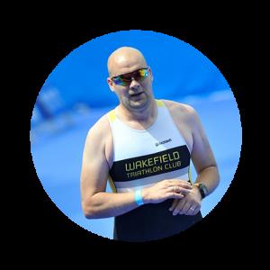 Phil Green running in a Wakefield triathlon vest