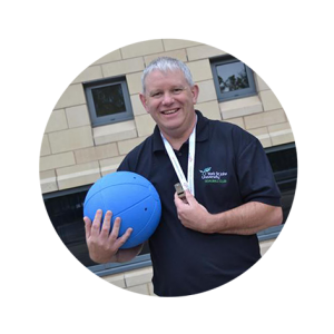 Rob Avery holding a goalball amd a whistle