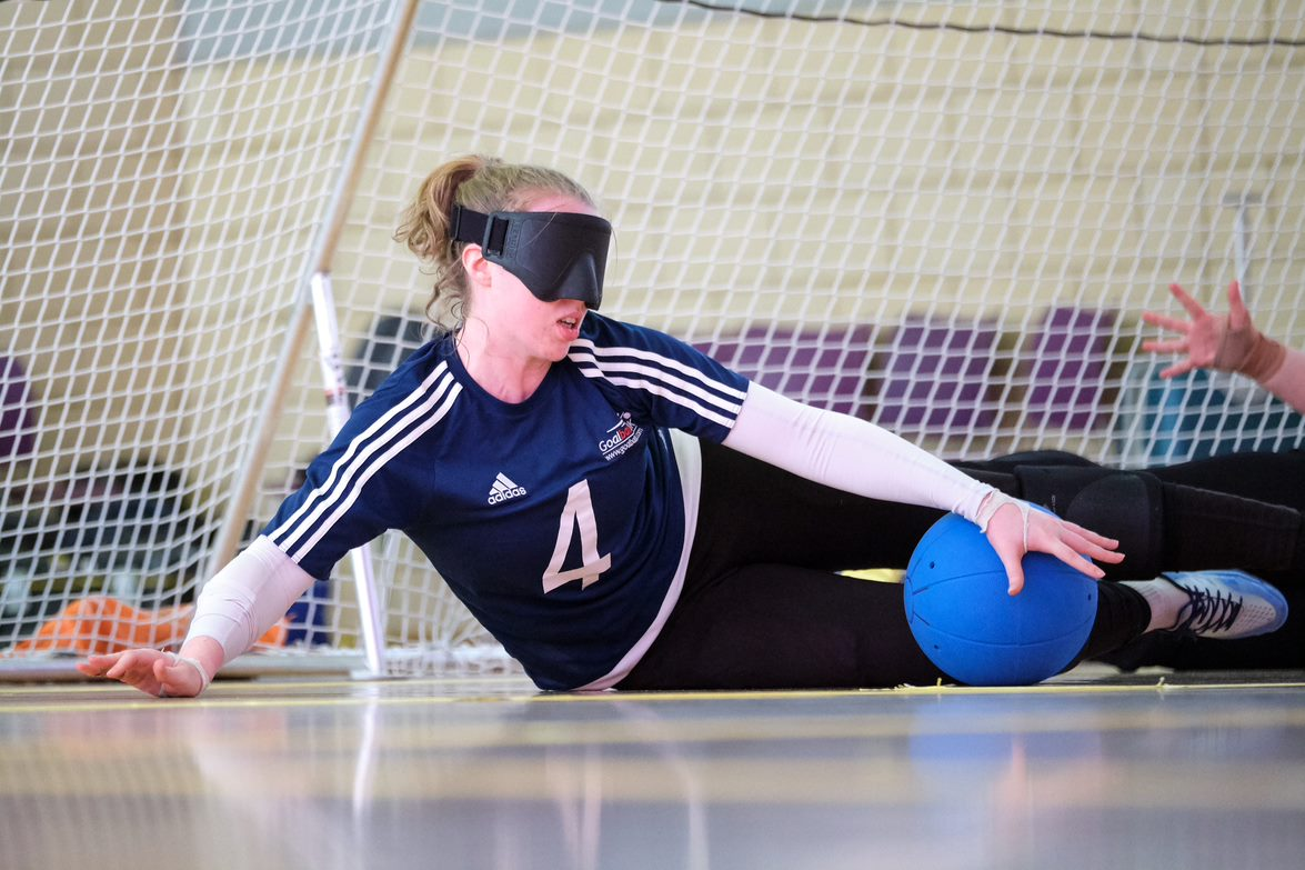 Action shot of Georgie Bullen playing goalball in her GB womens kit