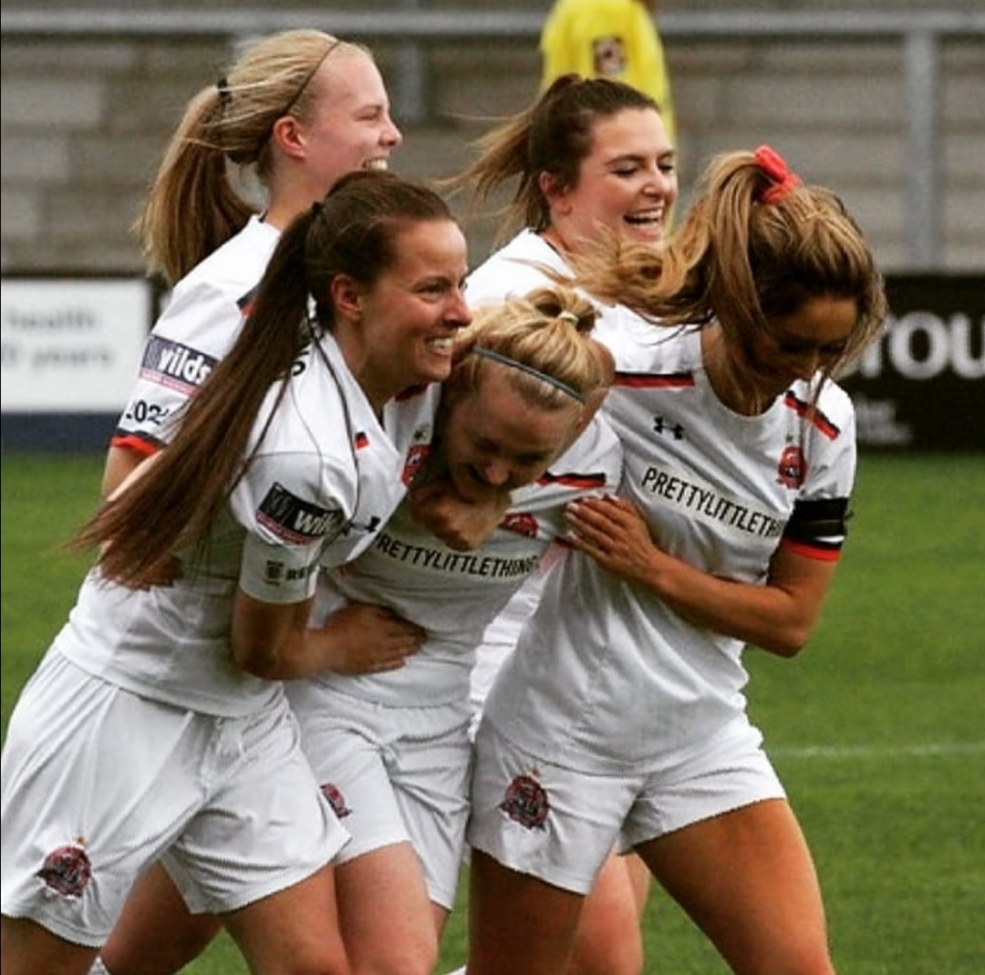 Jodie Redgrave, pictured in the middle of the image amongst her team mates at Fylde FC celebrating a goal!