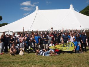 Group photo of Look members stood outside a big marquee at the Look festival.