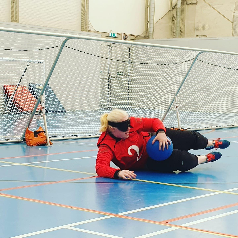 Sammie Korosi saving a goalball whilst playing for Lancashire Lions.