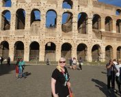 Sammie Korosi in front of the Colosseum in Rome, Italy on a very sunny day!